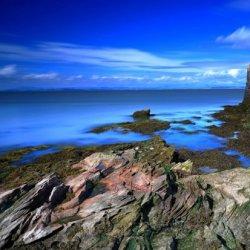 大海边的美丽灯塔图片